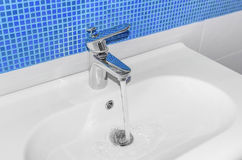 The water flows from faucet. Royalty Free Stock Photography