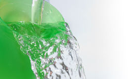 Water flows from the glass Royalty Free Stock Photography