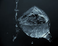 Water flows from the glass. water being poured into a glass Stock Images