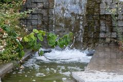 Water flows through the granite steps Royalty Free Stock Photography