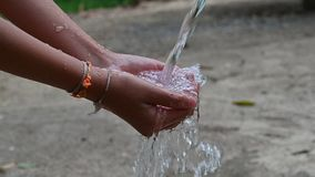 The water flows on the hands of people video Slow motion 120 frames stock video