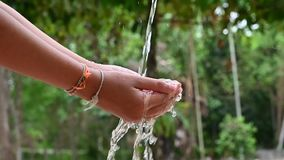 The water flows on the hands of people video Slow motion 120 frames stock video footage
