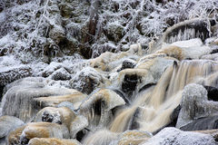 Water flows through the icy rocks Royalty Free Stock Photo
