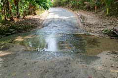 The water flows through the road. The water flows through the mountain road royalty free stock images