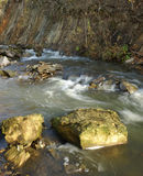 Water flows in a mountain stream Stock Images