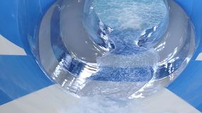 Water flows out of pipe in empty water park. water slides in amusement park. slow motion. Water flows out of pipe in empty water park. water slides in amusement stock footage