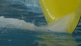 Water flows out of pipe in water park. water slides in amusement park. 4K. Water flows out of pipe in water park. water slides in amusement park stock video footage