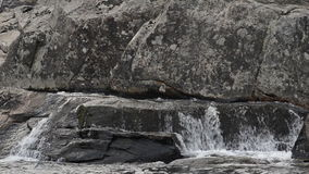 Water Flows Over Large Rocks at Linville Falls stock video footage