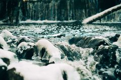 Water flows over a partially frozen Upper Cataract Falls in rural Indiana. Stock Images