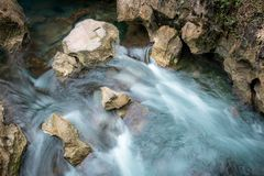 Water flows over rocks taken by low shutter speed stock images