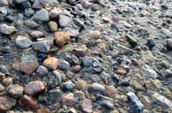 Water flows over stones. Water flows over an abstract pattern of stones Stock Photo
