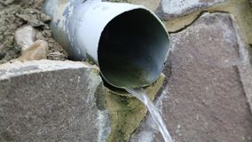 Water flows from pipe stock video footage
