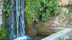 The water flows into a small pond.  stock footage