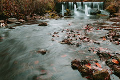 Water flows on stock pipes and follows in the wood. Royalty Free Stock Photos