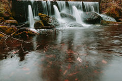 Water flows on stock pipes and follows in the wood. Stock Image