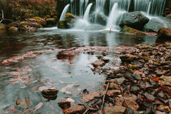 Water flows on stock pipes and follows in the wood. Stock Photo