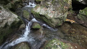 Water flows between stones in wild nature Royalty Free Stock Photos