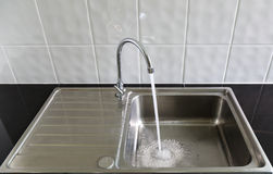 Water flows from the tap Stock Photos
