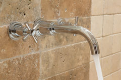 Water flows from the tap. Stock Photos