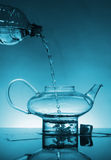 Water flows into teapot Royalty Free Stock Photography