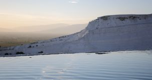 Water flows from terrace in Cotton Castle in Pamukkale Turkey. Water trickles down from one of the terraces of the Cotton Castle in Pamukkale Turkey stock video footage