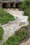 Water flows under the bridge. Stock Photos