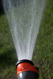 Water flying out of the hose Royalty Free Stock Image