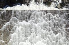 Water foam dam Stock Photo