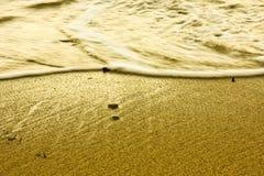 Water foam on sand Stock Photo