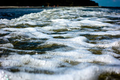 Water foam waves ocean sunny day light Royalty Free Stock Image