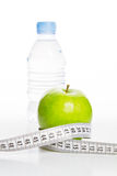 Water ,Food for diet 2. Measurement tape wrapped around green apple/Concept for health and diet Stock Images