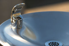 Water fountain. Macro view of stainless steel water fountain stock photos