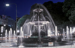 Water fountain on Avenida 9 de Julio at Night, Widest Avenue in the World, Buenos Aires, Argentina Stock Photo