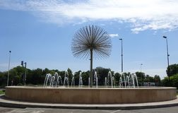 Fountains in Puteaux - Dandelion Flower shaped - Landmarks - Ile de Puteaux. Dandelion Flower Pollen shaped Water Fountain with a blue sky backdrop and trees Royalty Free Stock Photos