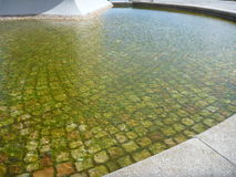Water fountain bottom paved with cobbles Royalty Free Stock Photography