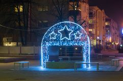 Water fountain with christmas decorations in Pruszcz Gdanski. Pruszcz Gdanski, Poland - December 18, 2017: Water fountain with christmas decorations in Pruszcz Royalty Free Stock Image