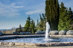 Water fountain feature in a garden Royalty Free Stock Image