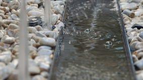 Water fountain flowing on rocks stock video
