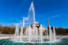 Water fountain. Former Orthodox church Hagia Sofia in the background. Royalty Free Stock Images