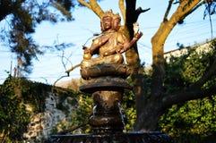 Water fountain of Hindu gods. In a beautiful garden royalty free stock photo