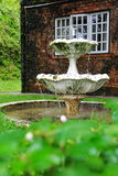 Water fountain in a home garden. Water fountain in the garden of an old english house stock photography