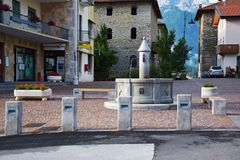 Water fountain and houses in Cadore Royalty Free Stock Photo