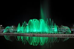 Water Fountain in Kota Kinabalu. Water fountain illuminated by green light stock images