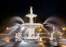 Water Fountain at Night. Forsyth fountain in historic Savannah, Georgia. Dramatic view with statues and water spray stock photo