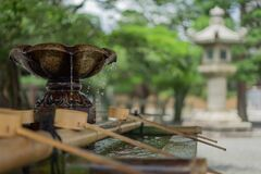 Water fountain at pagoda Royalty Free Stock Image