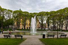 Water Fountain on Park Surrounded by Bench during Daytime Stock Image