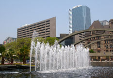 Water fountain and skscrapers stock photography