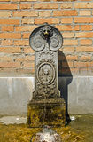 Water fountain, Venice. A traditional water fountain as found throughout the city of Venice, Italy.  This one is beside the main bus station at Piazzale Roma Stock Photos