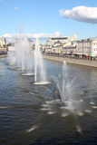 Water fountains in the middle of the river Stock Images