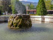 Water fountaint in city park in Skopje with background stock photos